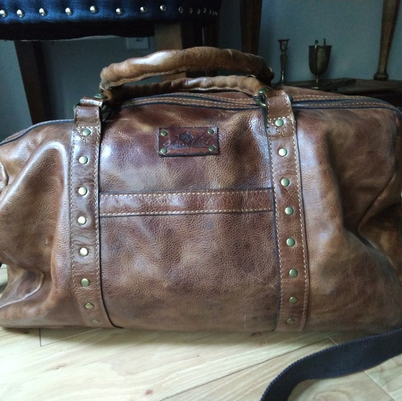 a56292dc6 Milano Duffel Bag from Patricia Nash distressed. M_5c896ef5bb76152eefbcd636